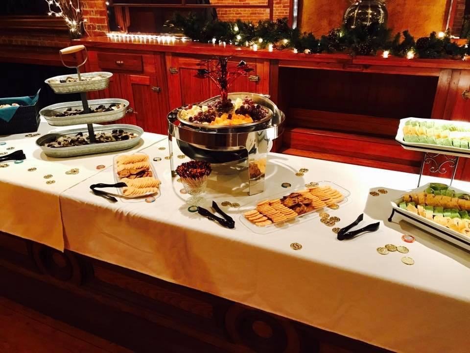Spread of appetizers on display at a catered holiday party